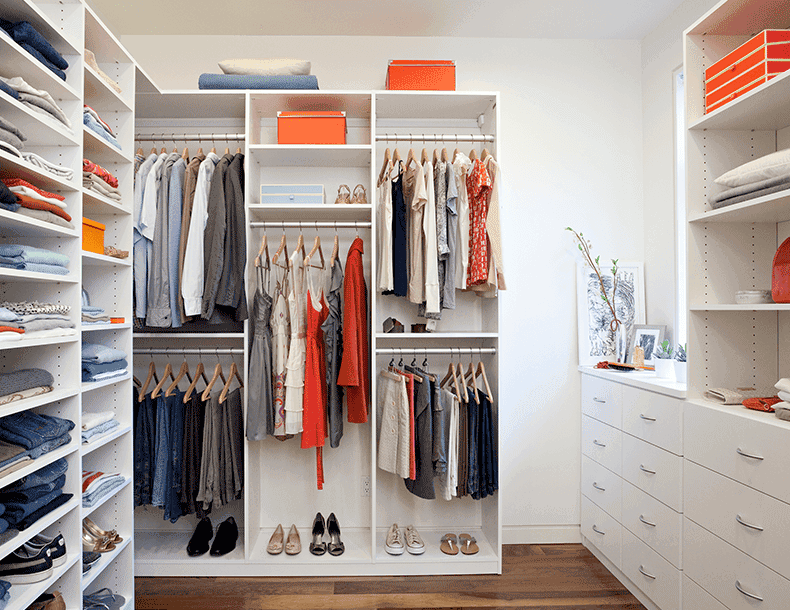Walk in Closet with White Shelving Closet Rods and Dresser Drawers