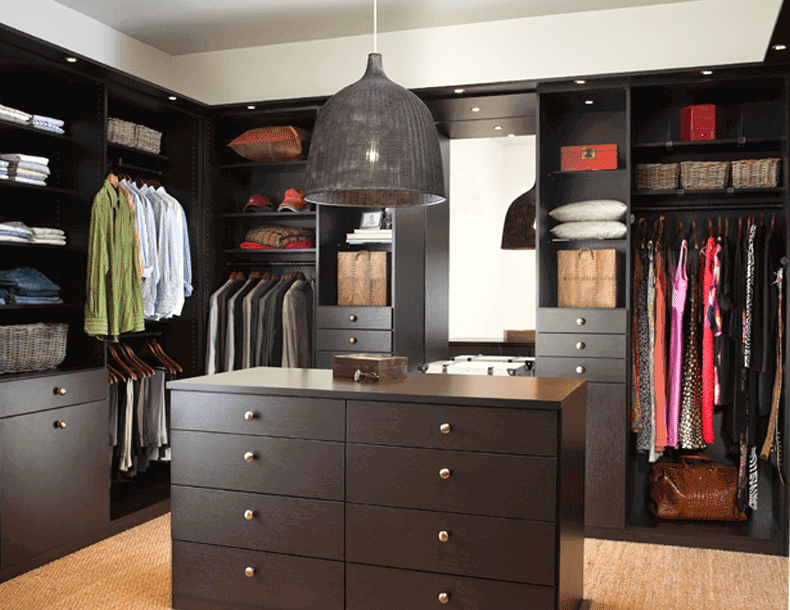 Dark Wood Walk in Closet with Shelving Drawers Closet Rods Built in Lighting and Island Dresser