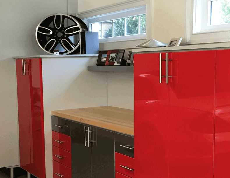 Garage Storage with White Cabinets Black and Red High Gloss Cabinet Doors and Storage Drawers and Light Wood Workspace Counter