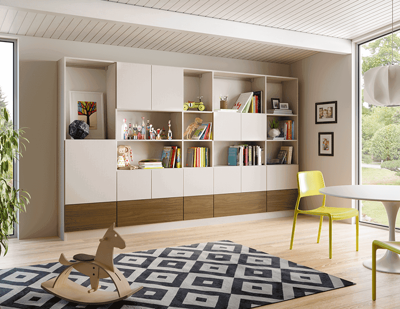 Built in Family Room Storage with White Shelving and Cabinets and Dark Wood Accent Panels