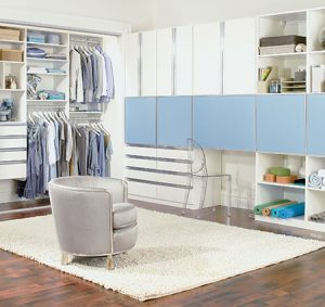 Multipurpose Room with White Shelving Reach in Closet Storage Drawers and Built in Desk