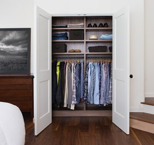 Dark Wood Reach in Closet with Shelves and Closet Rods