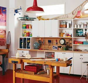 White Garage Storage with Shelving Cabinets Tool Rack Island Work Bench and Light Wood Counter Top