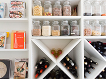 Close Up Image of White Pantry Storage with Shelving and X Design Cubbies