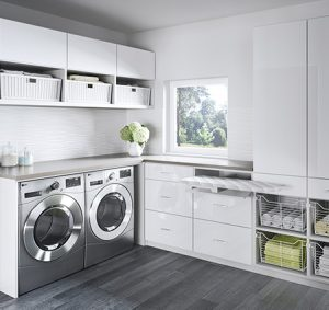 White Laundry Room Storage with Cabinets Drawers Wicker Baskets and Slide out Metal Baskets and Ironing Board