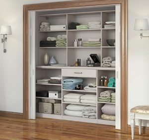 White Reach in Linen Closet with Shelving Drawers and Sliding Doors