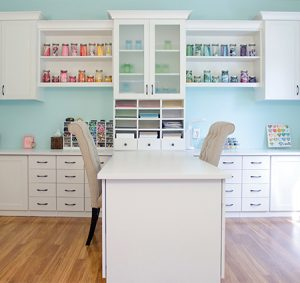 Craft Room with White Shelving Drawers Counter Spaces Cabients with Solid Wood and Frosted Glass Doors and a Built in Desk