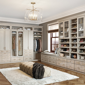 White Walk in Closet with Drawers Cabinets Shelving Chandelier Lighting and Glass Display Doors