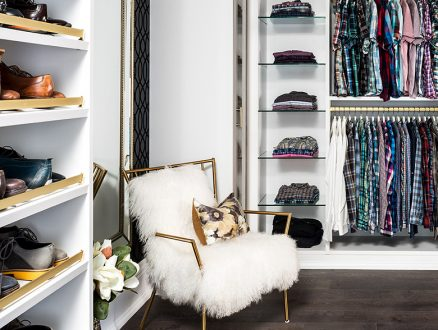 White and Gold Walk in Closet with Shoe Racks Closet Rods Glass Shelves and Fuzzy Chair