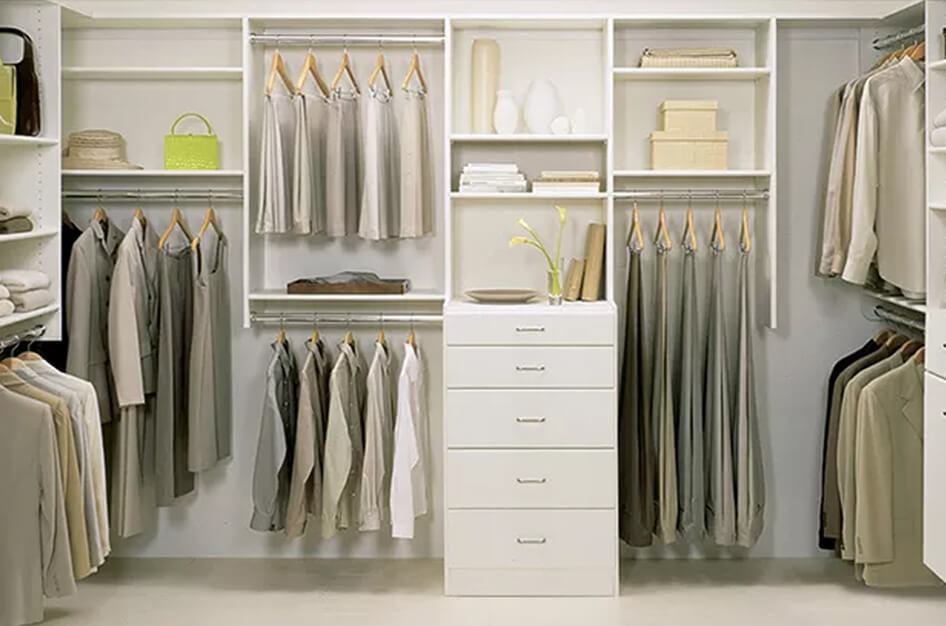 Neutral toned reach in closet with hanging poles and shelving