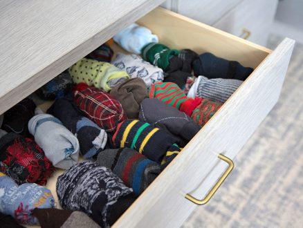 Davis Ligon Client Story Close Up Image of Light Grey Dresser Drawer with Socks