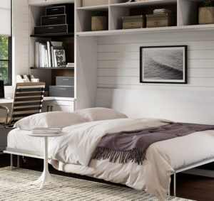 White wall bed in home office under white shelving